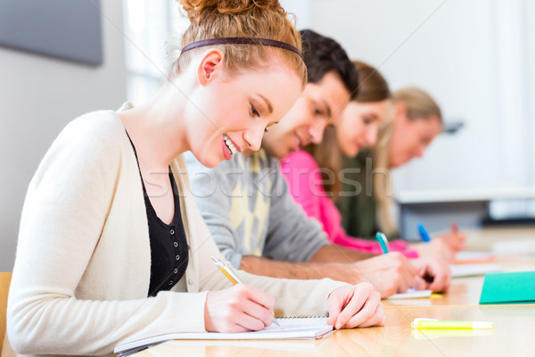 College students writing test or exam Stock photo © Kzenon