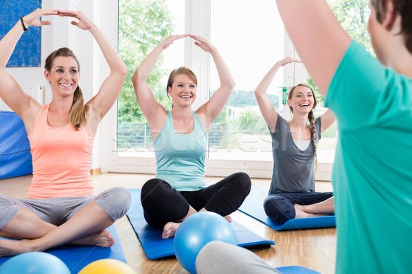 Moms in postnatal regression course doing yoga Stock photo © Kzenon
