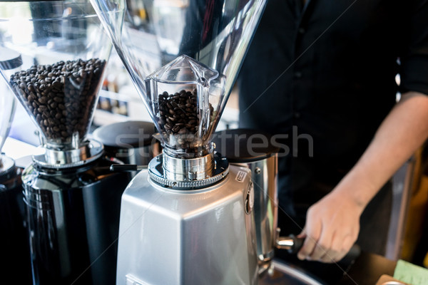 Young barista preparing coffee from fresh grinded roasted beans  Stock photo © Kzenon