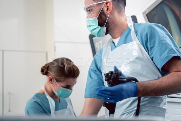 Team of doctors performing endoscopy in hospital Stock photo © Kzenon