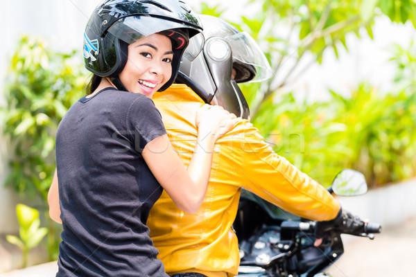 Mulher jovem equitação motocicleta namorado Foto stock © Kzenon