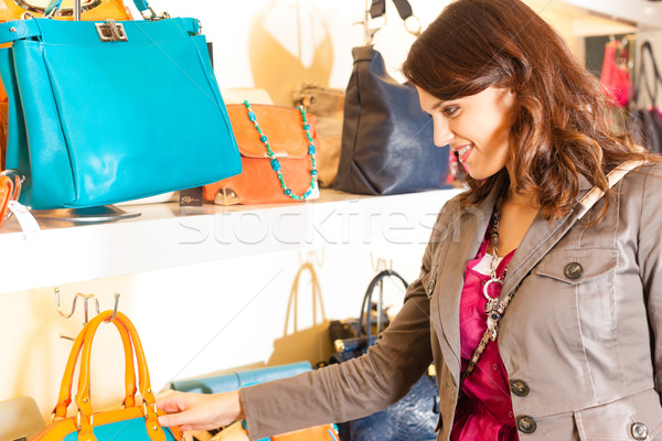 Woman buying a bag in mall Stock photo © Kzenon