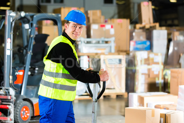 Storeman with mover at warehouse of forwarding Stock photo © Kzenon