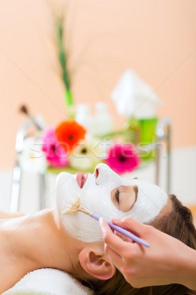Wellness - woman getting face mask in spa Stock photo © Kzenon