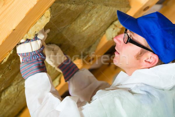 Worker setting thermal insulating material Stock photo © Kzenon
