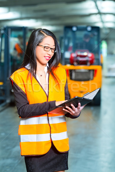 female employee or supervisor at warehouse Stock photo © Kzenon