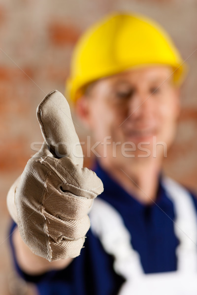 Friendly and reliable construction worker Stock photo © Kzenon