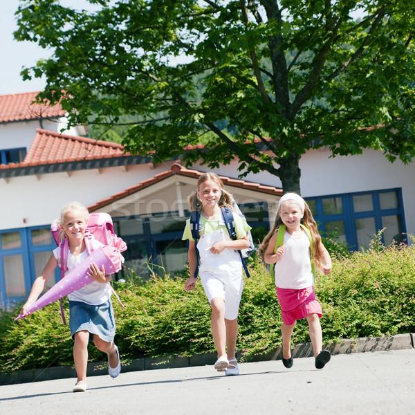 Three schoolchildren having fun Stock photo © Kzenon