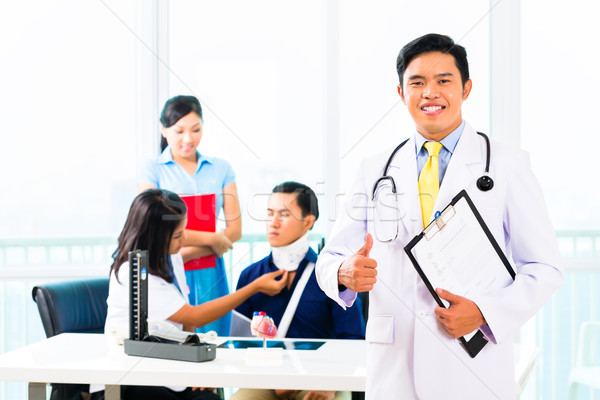 Asian doctor check-up on patient Stock photo © Kzenon