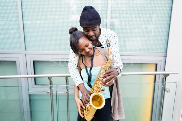 African couple playing Saxophone  Stock photo © Kzenon