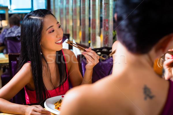 Giovani mangiare Asia ristorante alimentare donne Foto d'archivio © Kzenon