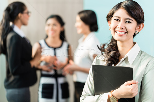 Indonesian Business woman in front of team Stock photo © Kzenon