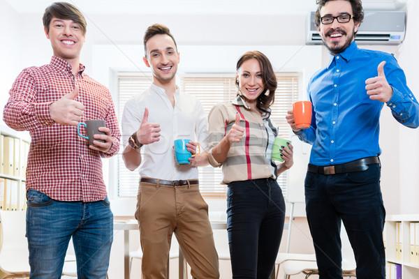 Young creative entrepreneurs being motivated Stock photo © Kzenon