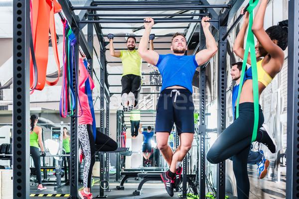 Grup kadın erkekler kafes uygunluk spor Stok fotoğraf © Kzenon