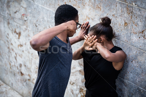 насильственный молодым человеком подруга кулаком улице женщину Сток-фото © Kzenon