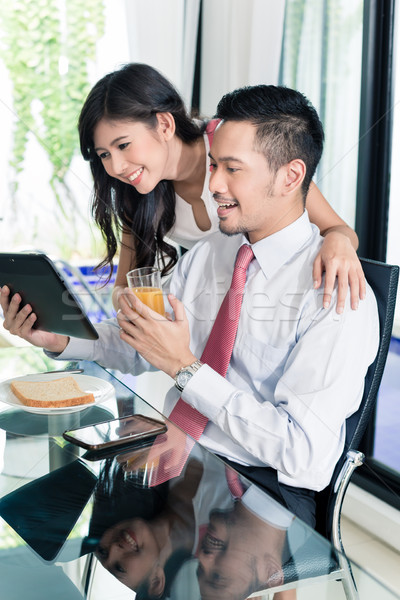 Stock photo: Couple having breakfast before man goes to office
