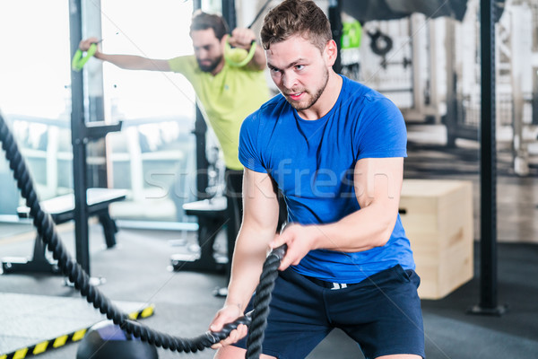 People in gym doing sport in functional fitness training Stock photo © Kzenon