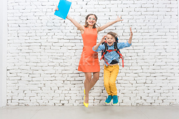 Student or pupil and teacher being excited about school  Stock photo © Kzenon