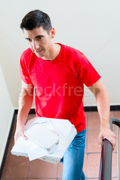 Fast food delivery man with boxes Stock photo © Kzenon