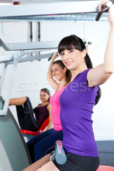 gym people doing strength or fitness training Stock photo © Kzenon