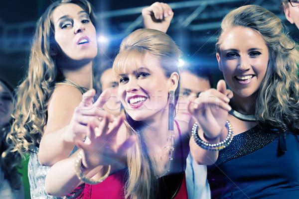 Fête personnes danse disco club jeunes Photo stock © Kzenon