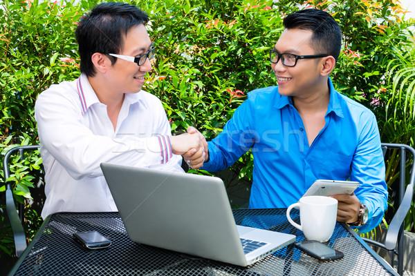 Asian Businessmen working outdoor Stock photo © Kzenon