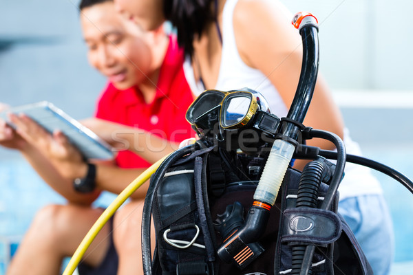Dive master and student in Asian diving school Stock photo © Kzenon