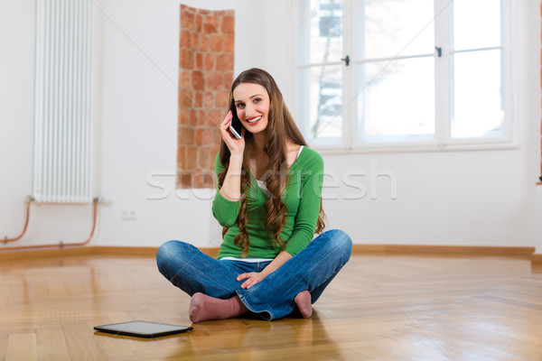 Young woman at home on the phone Stock photo © Kzenon