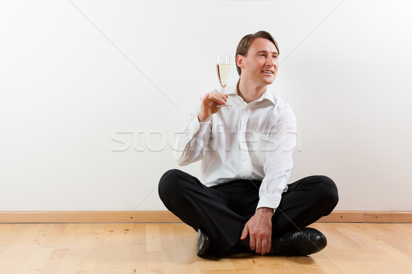 Man in apartment with champagne Stock photo © Kzenon