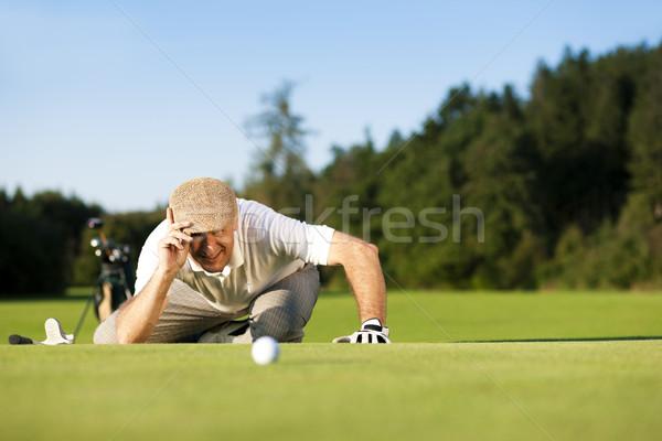 Senior jogador de golfe verão homem jogar golfe Foto stock © Kzenon