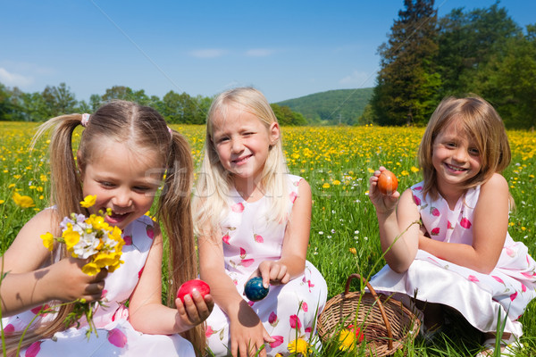 Stock photo: Children on Easter egg hunt with eggs