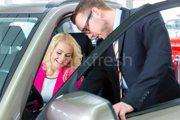 Woman buying new car in auto dealership  Stock photo © Kzenon
