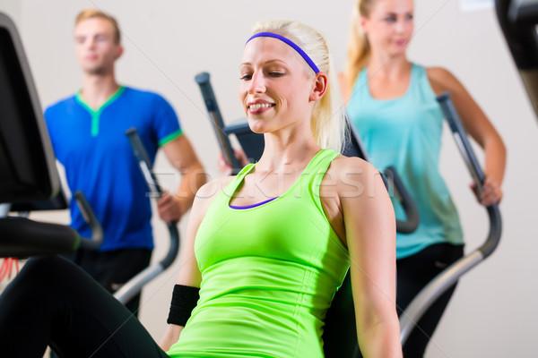 группа спортзал спорт велосипед фитнес люди Сток-фото © Kzenon