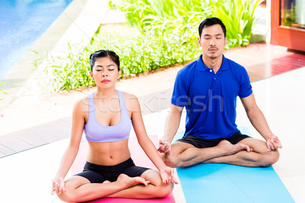 Asian yoga couple in lotus seat mediating Stock photo © Kzenon