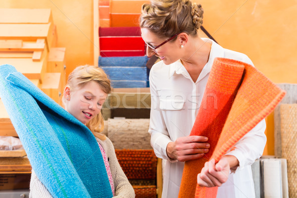 Family Designer buying rug or carpeting Stock photo © Kzenon