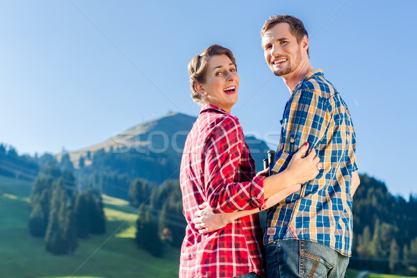 Man and woman hiking in the mountains Stock photo © Kzenon