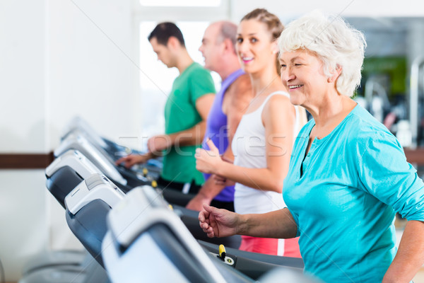 Group with senior people on treadmill in gym Stock photo © Kzenon
