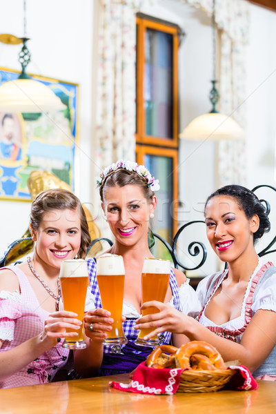 Group of people with wheat beer in Bavarian pub Stock photo © Kzenon