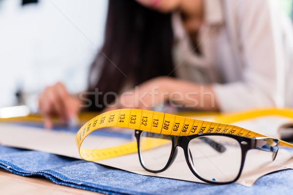 Detail of pattern, tape rule and glasses in fashion studio Stock photo © Kzenon