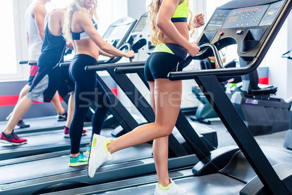 Treadmill group exercising in fitness gym Stock photo © Kzenon