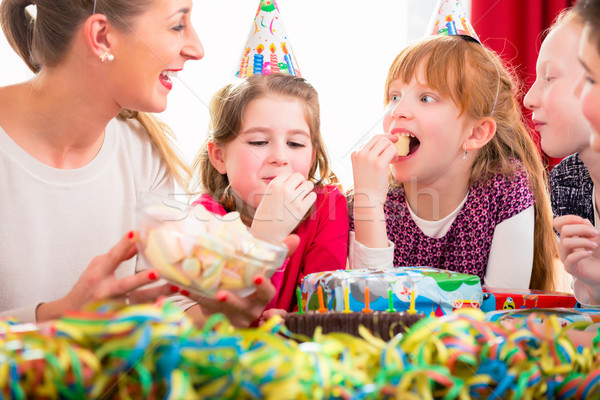Children on birthday party nibbling candies Stock photo © Kzenon