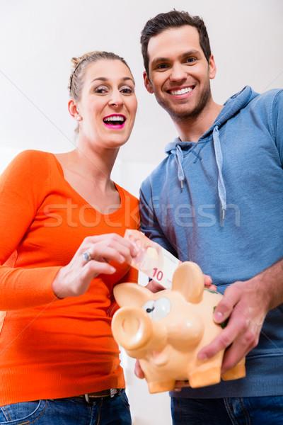 Couple saving money by moving house Stock photo © Kzenon