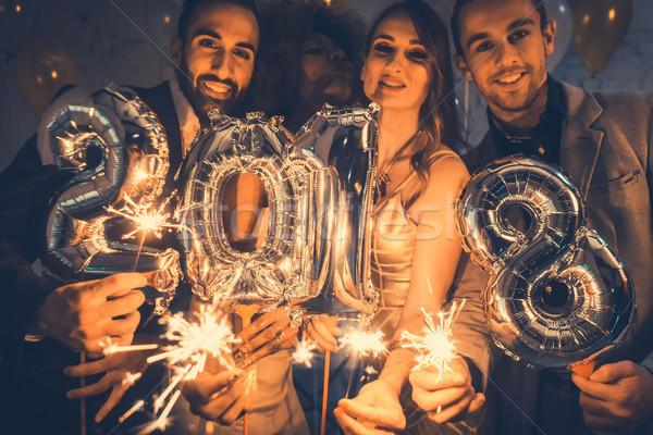 Men and women celebrating the new year 2018 Stock photo © Kzenon