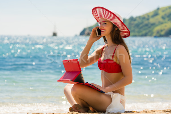 Fashionable young woman on the beach Stock photo © Kzenon