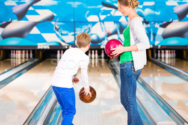 Mother and son playing together at bowling center Stock photo © Kzenon