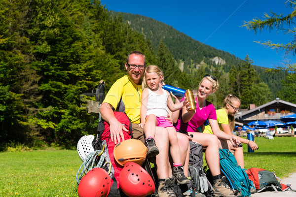 Family having break from hiking in the mountains Stock photo © Kzenon