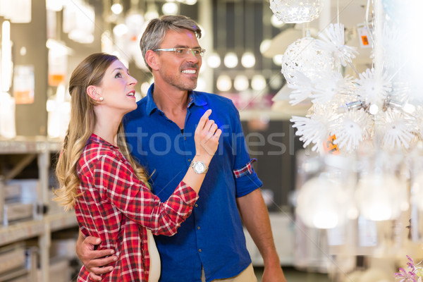 Customer in hardware store asking clerk for help  Stock photo © Kzenon