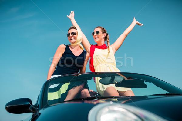 Stock photo: Woman having summer trip in convertible car