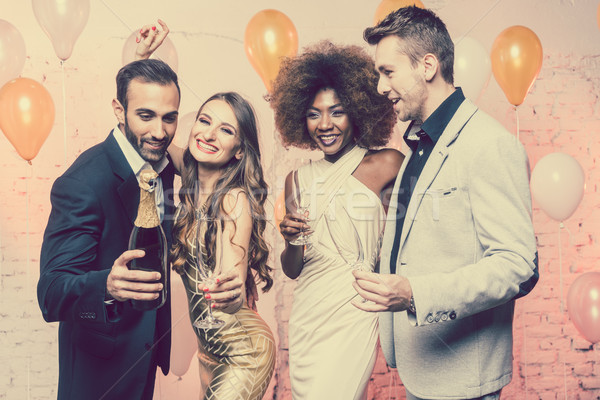 Couples in a club celebrating new years eve dancing into midnight Stock photo © Kzenon