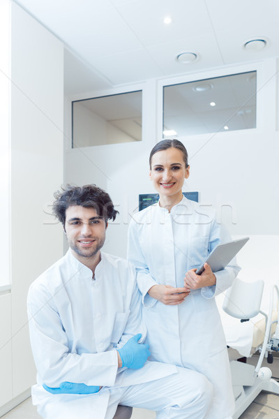 Doctor woman and man with tablet computer in their practice Stock photo © Kzenon